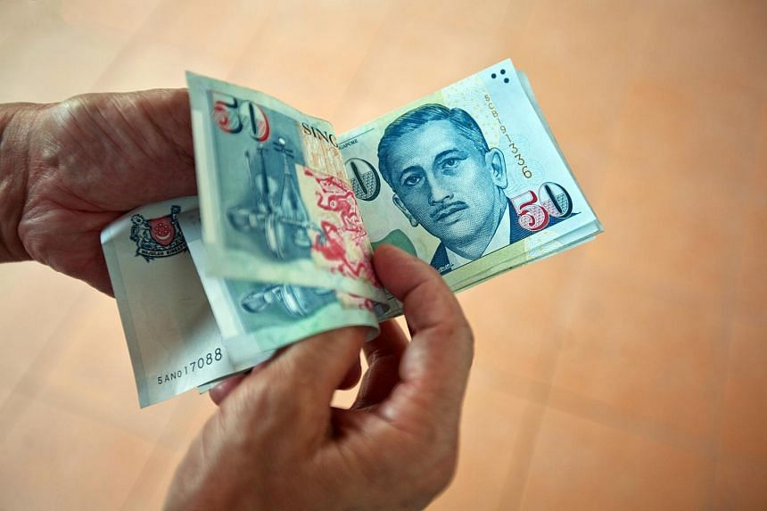 Singapore dollar banknotes are arranged for a photograph.