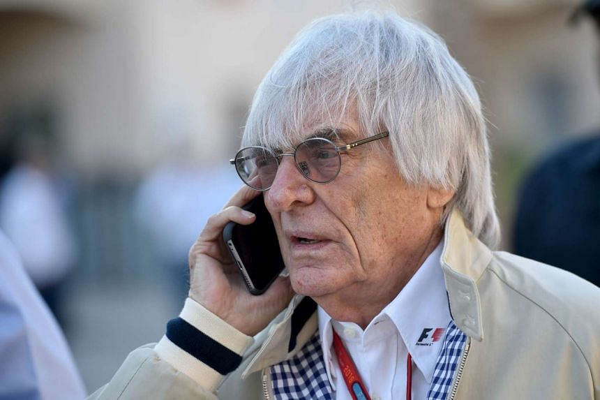Formula One boss Bernie Ecclestone speaking on the phone ahead of the Bahrain Formula One Grand Prix at the Sakhir circuit in Manama on April 3, 2016.