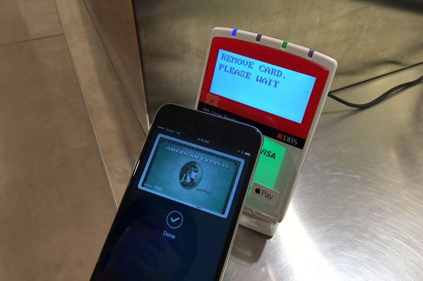 An American Express (Amex) card user in Singapore making a payment using an iPhone.