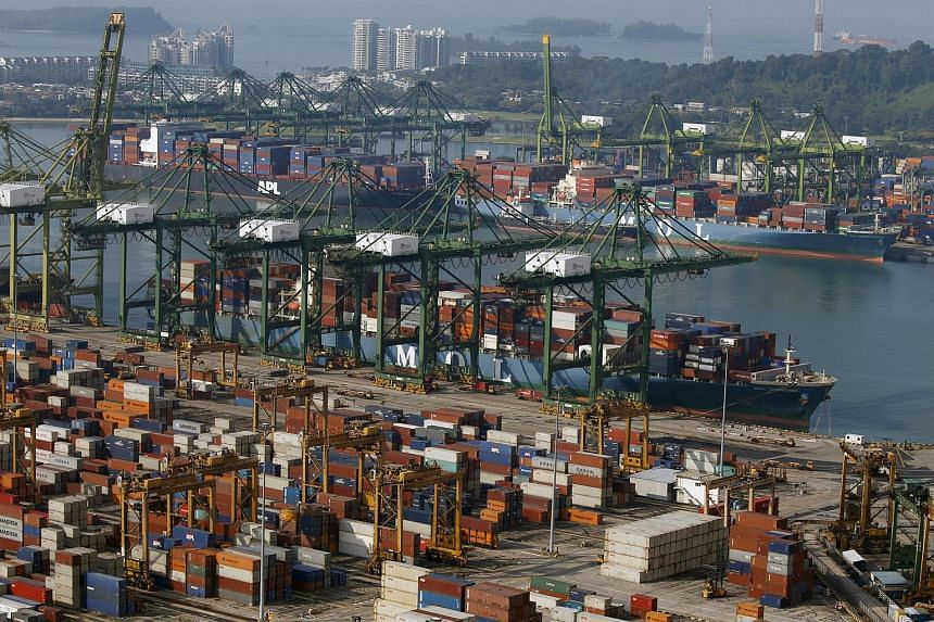 A ship docks at PSA's Tanjong Pagar container port in Singapore.