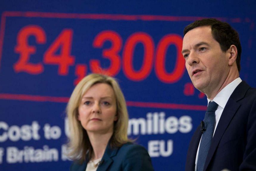 British Chancellor of the Exchequer George Osborne (right) speaks as British Environment Secretary Liz Truss listens at the Bristol and Bath Science Park on Monday (April 18).
