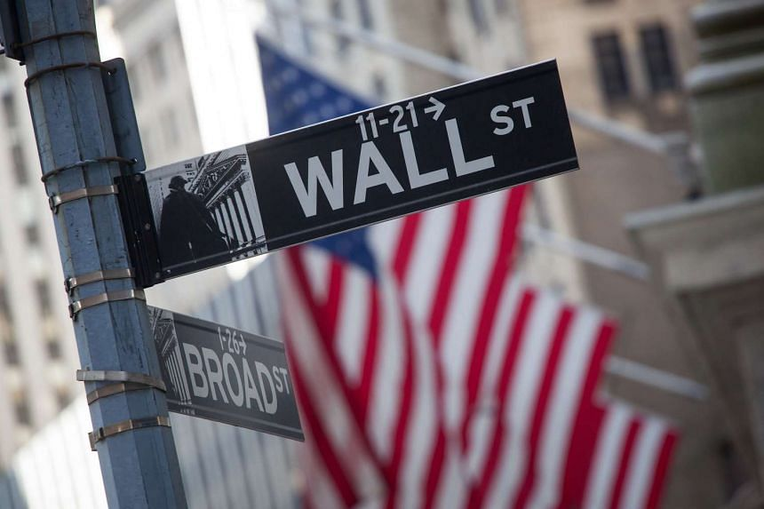 A Wall Street street sign is displayed in front of the New York Stock Exchange (NYSE) on Monday (April 18).