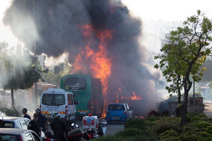 Flames rise at the scene where an explosion tore through a bus in Jerusalem on Monday setting a second bus on fire on Monday (April 18).
