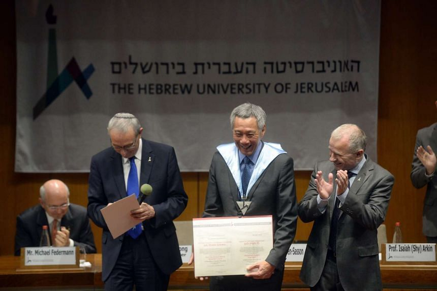 Prime Minister Lee Hsien Loong is conferred a Doctor Philosophiae Honoris Causa degree at the Hebrew University in Jerusalem on Monday (April 18) by the university's president, Prof Menahem Ben-Sasson (left),  and its rector, Prof Asher Cohen (right)