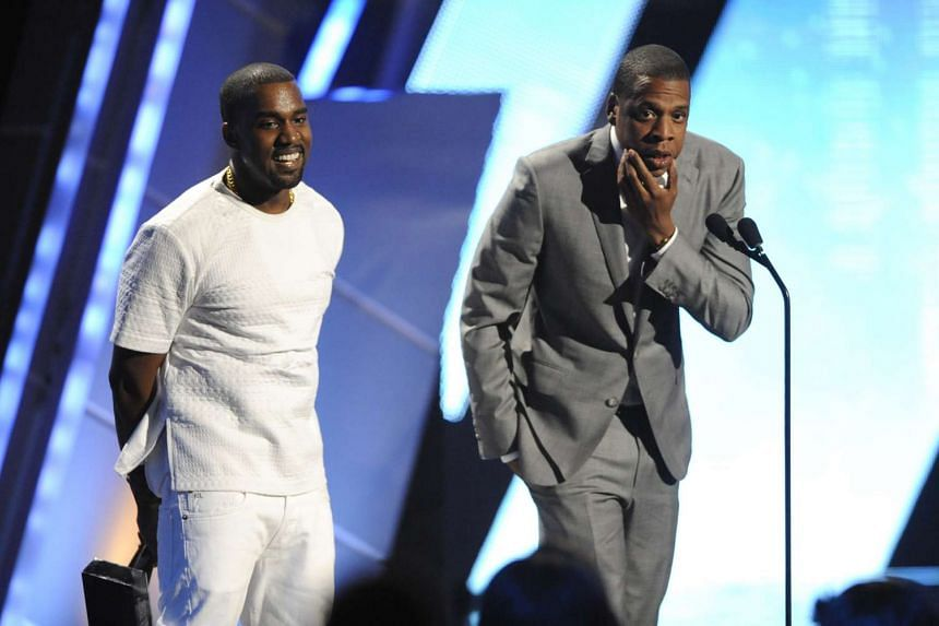 Kanye West and Jay-Z (right) accept the award for best group at the BET Awards in Los Angeles in 2012.