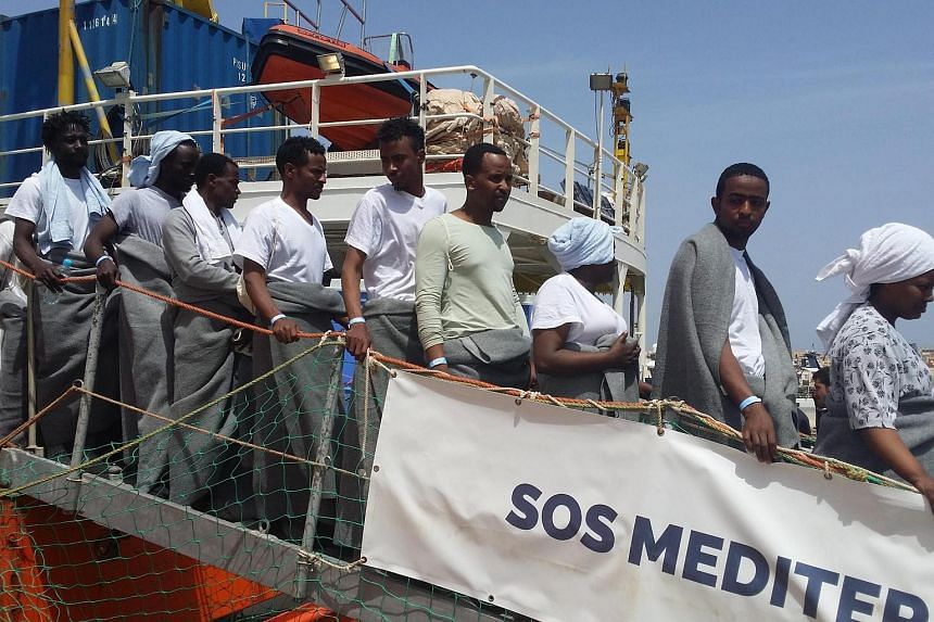 Migrants disembarking at Lampesusa's harbour from the Aquarius ship of the humanitarian group SOS Mediterranee, in Lampesusa, on April 18, 2016.
