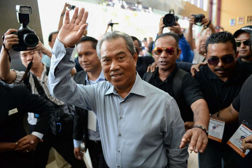 Malaysia's former deputy Prime Minister Muhyiddin Yassin (centre) arrives at a rally in Shah Alam on March 27, 2016.