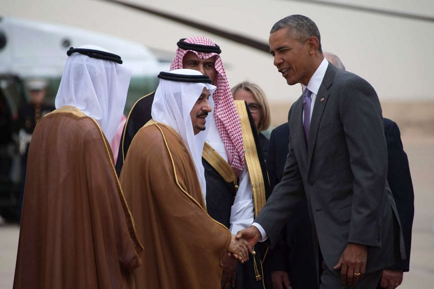 US President Barack Obama (right) shakes hands with Prince Faisal bin Bandar bin Abdelaziz al-Saud, Governor of Riyadh, as he arrives at King Khalid International Airport on April 20, 2016.