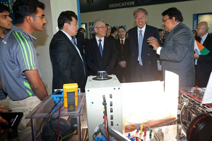 Deputy Prime Minister Teo Chee Hean (second from right) tours one of the exhibition booths during the launch of Sembcorp-NUS Corporate Laboratory.