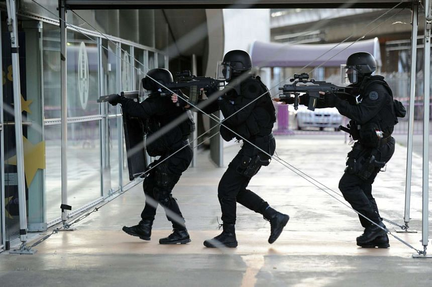 Members of the Raid, the French national police intervention group, take part in a simulation exercice of terrorist attack at the Toulouse stadium on April 14, 2016.