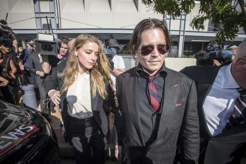 US actor Johnny Depp (right) and his wife US actress Amber Heard leave the Southport Magistrates Court in Southport, on the Gold Coast, Australia on April 18, 2016.
