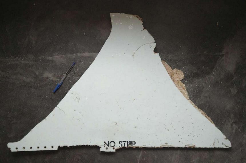 The Australian Transport Safety Bureau determined that a piece of metal found on a beach in Mozambique came from the missing Malaysia Airlines flight MH370.