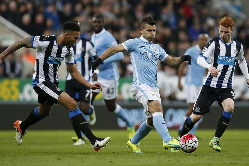 Manchester City's Sergio Aguero in action with Newcastle's Jack Colback and Jamaal Lascelles at the Barclays Premier League at St James' Park on April 19, 2016.