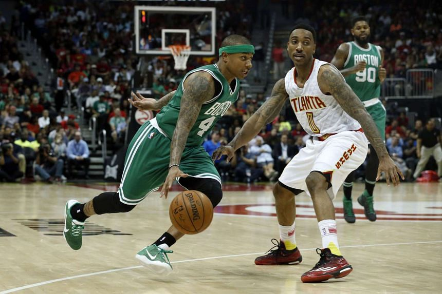 Boston Celtics guard Isaiah Thomas (left) drives against Atlanta Hawks guard Jeff Teague during their game at Philips Arena on April 19, 2016.