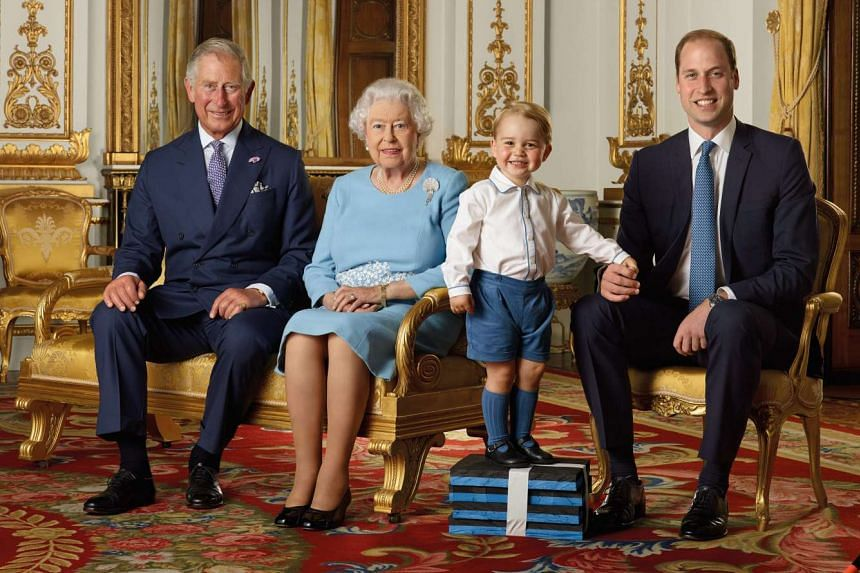 Britain's Prince George (second from right) joins his father Prince William, grandfather Prince Charles, and great-grandmother Queen Elizabeth II in a photoshoot for a stamp sheet to mark the Queen's 90th birthday.