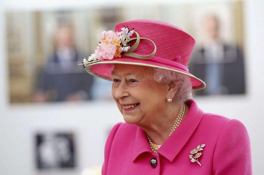 Queen Elizabeth II arrives at the Queen Elizabeth II delivery office in Windsor on April 20, 2016 in Windsor, Britain.