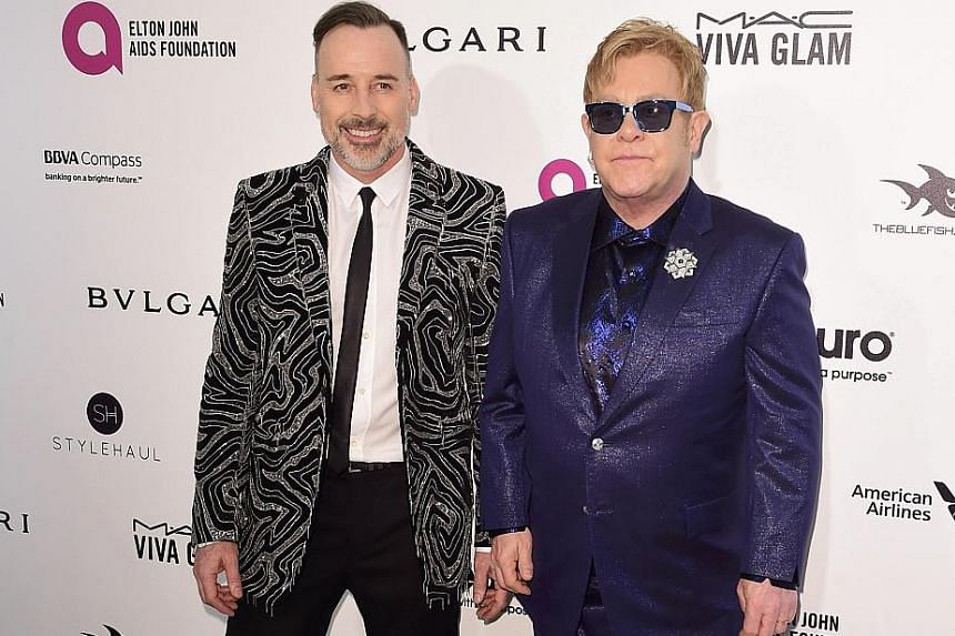 Elton John and his partner David Furnish (both above).