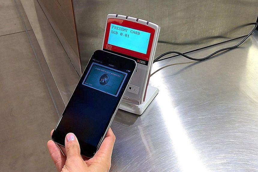 With Apple Pay, users just need to tap their device, like this iPhone 6s Plus, on a supported NFC payment reader.