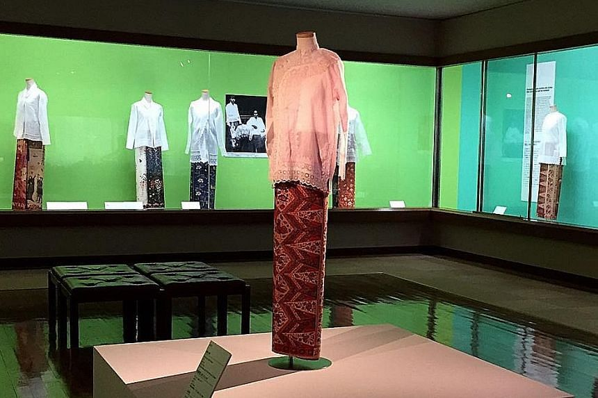 The blouse, or baju peki, on the platform is a gift from the family of Singapore's Mr Lee Kip Lee to the Fukuoka Art Museum and is part of its exhibition, Singapore, Sarong Kebaya And Style.