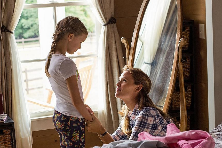 Jennifer Garner plays Christy, a mother whose faith is put to the test as she cares for her daughter Anna (Kylie Rogers, both above), who suffers from a debilitating disease.