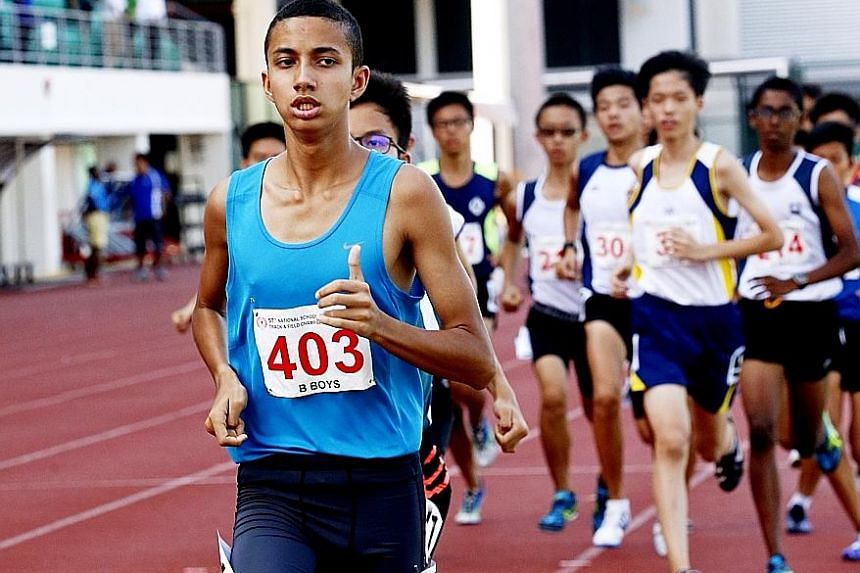 VJC's Nicole Low competing in the A Division 3,000m final yesterday at Bishan Stadium. Her time of 10min 57.61sec beat a record that had stood for 13 years. Right: Pasir Ris Secondary School's lone runner, Syed Hussein, who won the B Division cross-c