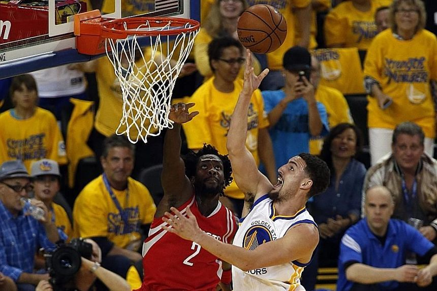 Warriors guard Klay Thompson (right) drives past Rockets guard Patrick Beverley during the 115-106 victory against Houston in Game 2 of the Western Conference play-offs.