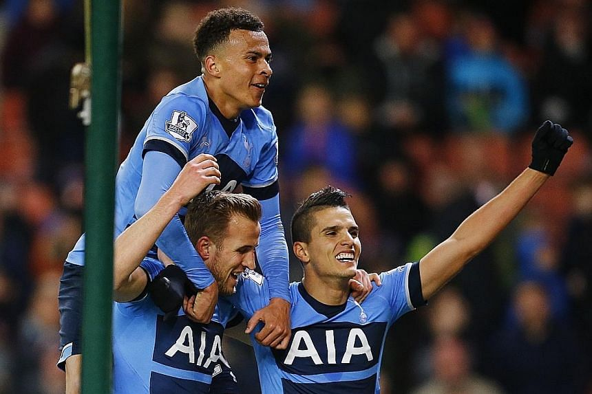 Tottenham's Dele Alli (clockwise from top) and Erik Lamela celebrate Harry Kane's strike, Spurs' third, in a 4-0 win over Stoke City at the Britannia Stadium.