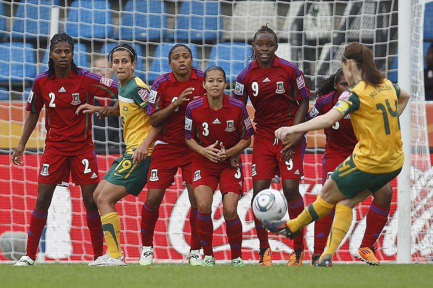 The Equatorial Guinea women's team employ a defensive wall against Australia in 2011. Last week, the Central African nation was turfed out of the qualifying tournament for the 2020 Olympics after Fifa found out that one of their players had used two