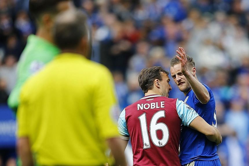 A frustrated Jamie Vardy had to be restrained by West Ham's Mark Noble while leaving the field after being sent off. Referee Jon Moss showed Leicester's top scorer a second yellow card for simulation.