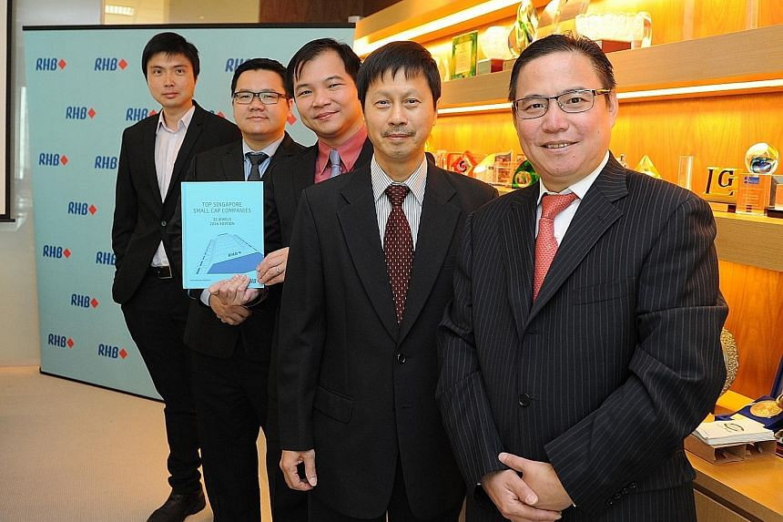 Among those at the handbook's launch yesterday were (from right) Mr Meng, China Aviation Oil CEO, Mr Hew, Fu Yu CEO, Mr Ong, RHB Research Singapore head, IPS Securex chief operating officer Brandon Lee and Mr Ng, Sinarmas Land executive director. Mr