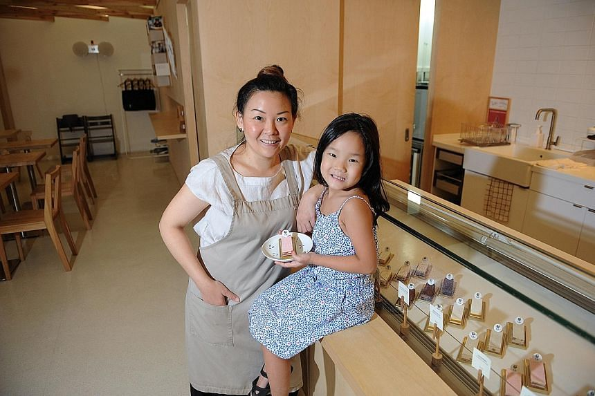 Kki Sweets's Ms Liau and her daughter Shannon at the outlet in the School of the Arts. Ms Liau and her husband were inspired to set up shop after their honeymoon in Japan.