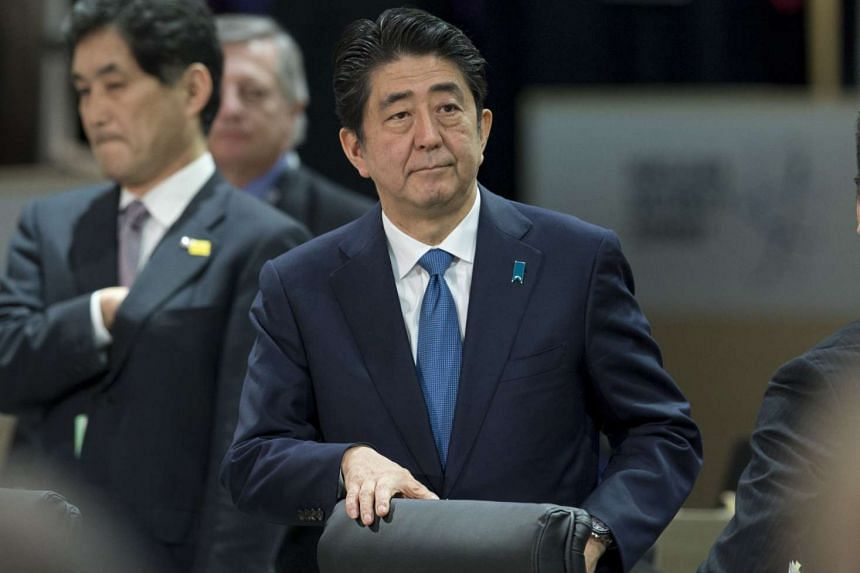 Japanese Prime Minister Shinzo Abe attending a plenary session during the 2016 Nuclear Security Summit in Washington, DC, on April 1, 2016.