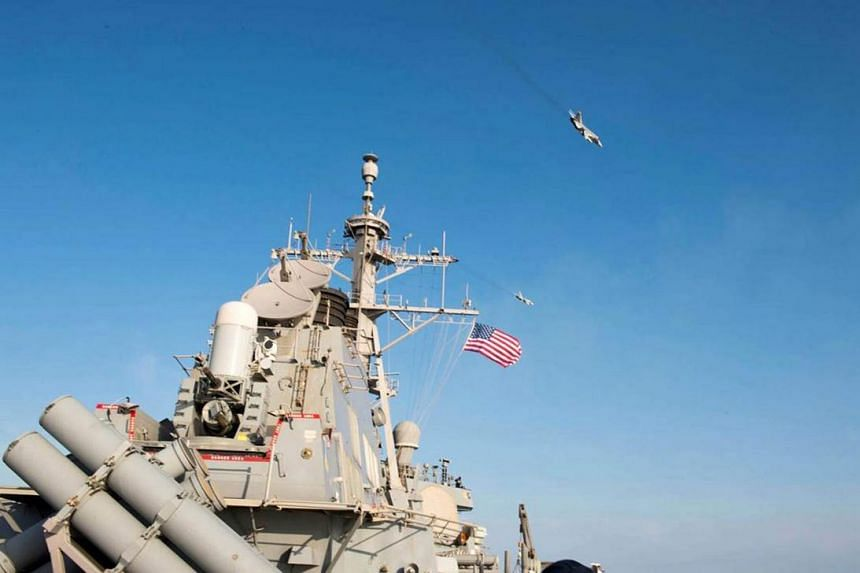 A handout image made available on 13 April 2016 by the US Navy shows two Russian Sukhoi Su-24 attack aircraft fly over the USS Donald Cook (DDG 75) in the Baltic Sea, 12 April 2016. Donald Cook, an Arleigh Burke-class guided-missile destroyer forward