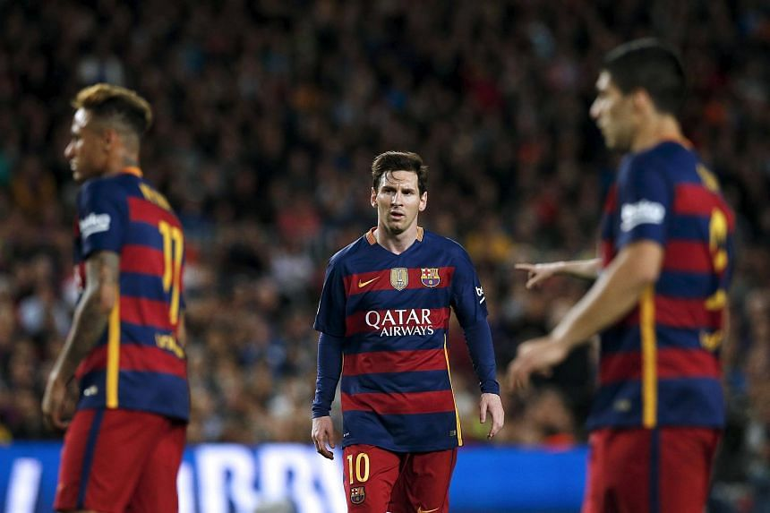 Barcelona's Luis Suarez, Neymar and Messi react against Valencia during a football match on April 17, 2016.