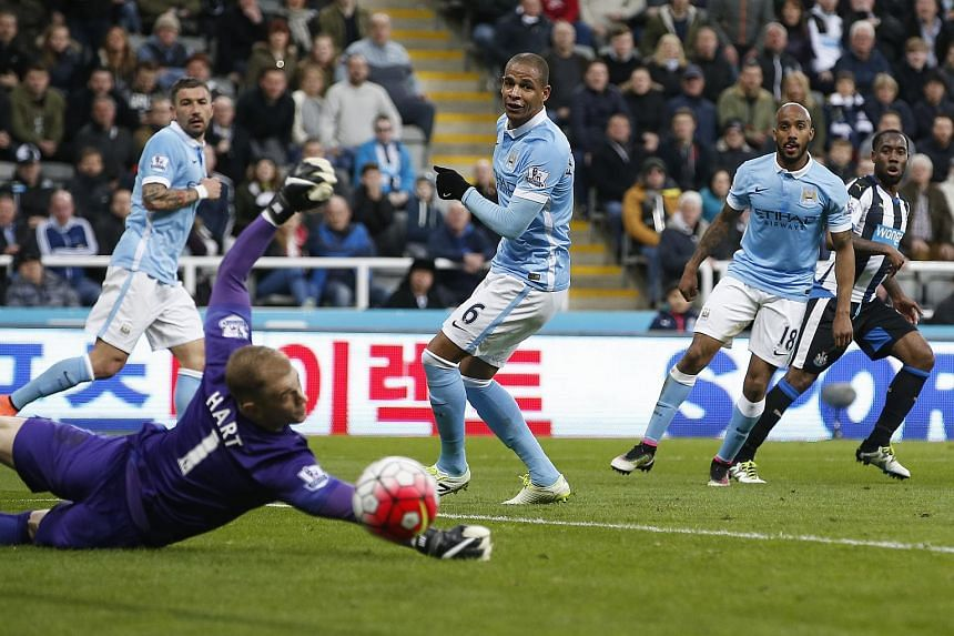 Vurnon Anita (right) scores the first goal for Newcastle United against Manchester City.