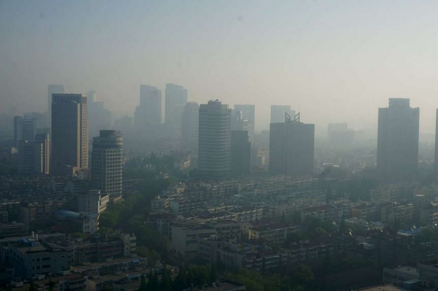 Buildings are seen during a moderately polluted day in Nanjing, Jiangsu Province, China, on April 19, 2016.