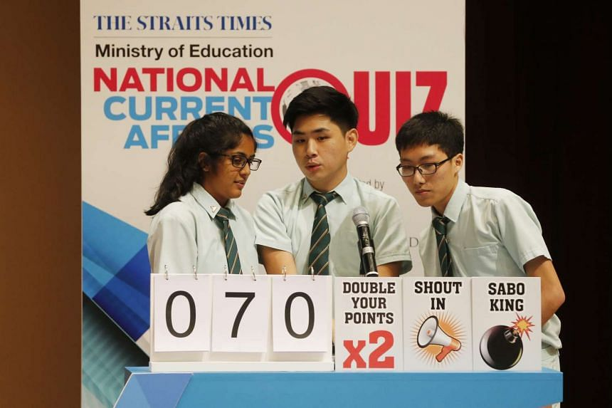 Tampines Junior College students (from left) Reshma Kaur Selvaruben, Ronnie Lai and Peh Yee Jie discussing answers during the Big Quiz round on April 20, 2016.
