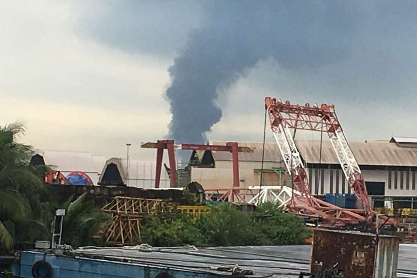 Plumes of smoke are seen rising from an oil tank on Jurong Island, on April 20, 2016.
