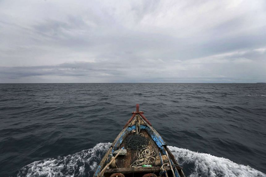 File photograph of a boat heading towards fishing grounds off the east coast of Natuna Besar, Indonesia.