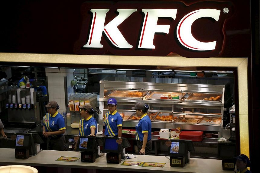 Employees working at a KFC store in Shanghai in this July 29, 2014, file photo.