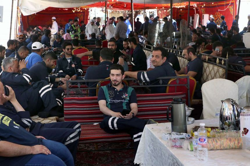 Kuwaiti oil workers sit at the union's headquarters in Al-Ahmadi as they participate in the third day of strikes.