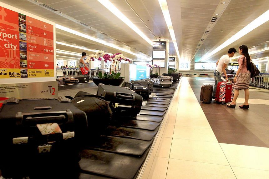 Passengers collecting their luggage at Changi Airport Terminal 2.