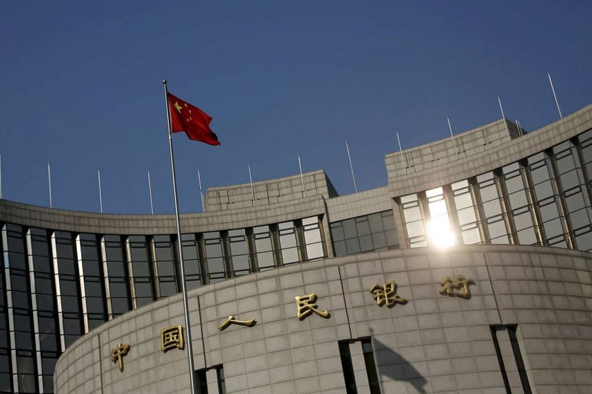 A Chinese national flag flying at the headquarters of the People's Bank of China in Beijing, China, on Jan 19, 2016.