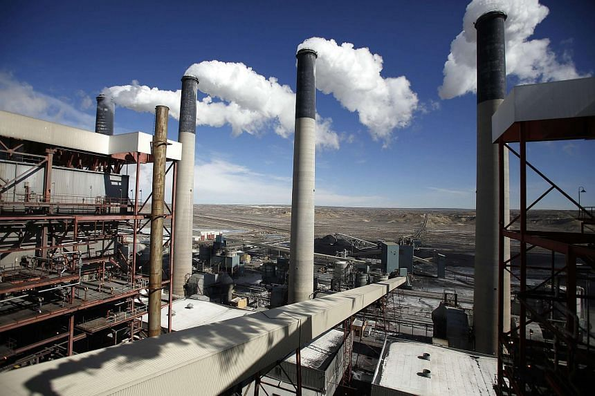 Steam rises from the stakes of the coal-fired power plant in Wyoming.