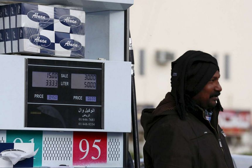 A worker filling a car with fuel at a petrol station in Riyadh, Saudi Arabia, in this Dec 22, 2015, file photo.