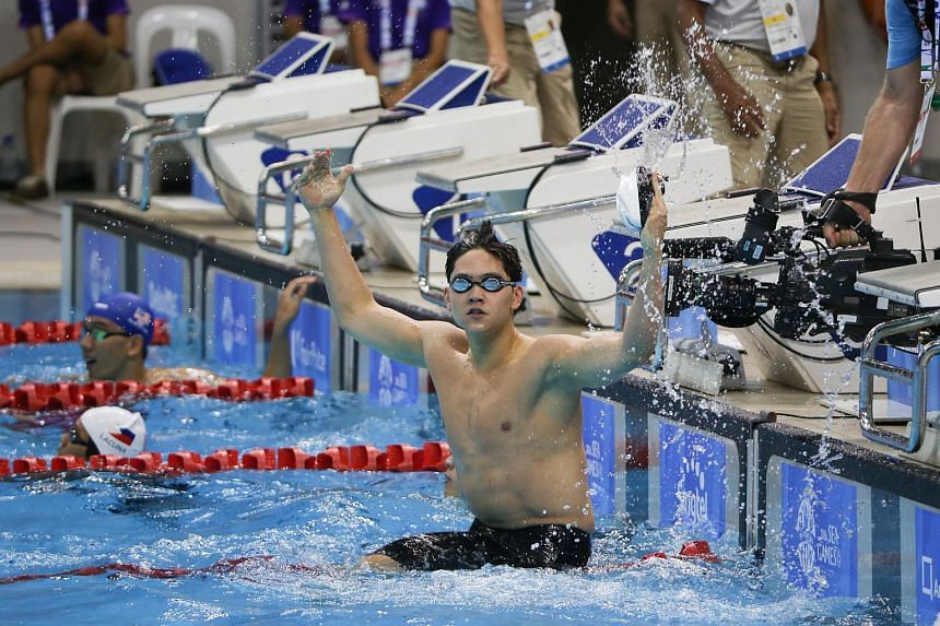 Joseph Schooling reacts after the Men's 100m freestyle during the 28th SEA Games.