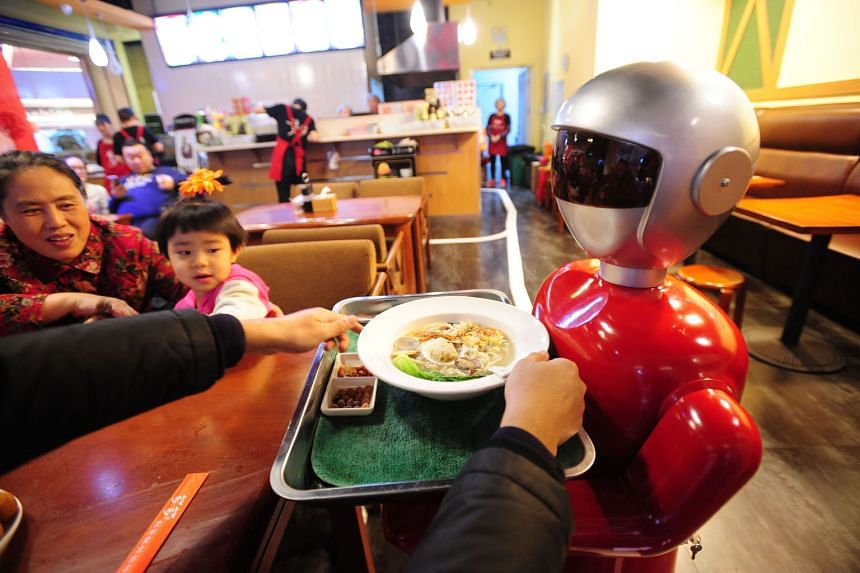 Little Flower, a robot, in a Shenyang restaurant. Several restaurants have stopped using robots for their inability to perform tasks such as handling soup dishes, but Little Flower seems to be managing quite well .