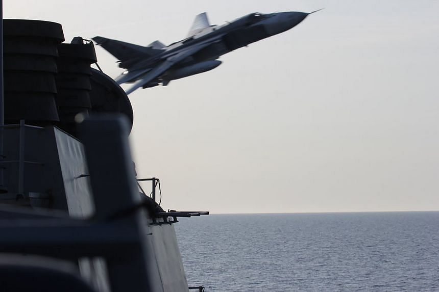 A US Navy picture shows a Russian Sukhoi SU-24 aircraft flying past the USS Donald Cook in the Baltic Sea on April 12.