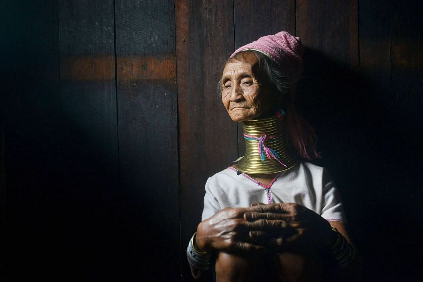 A 76-year-old tribeswoman named Monu at her home in Panpet village in Myanmar's Kayah state.