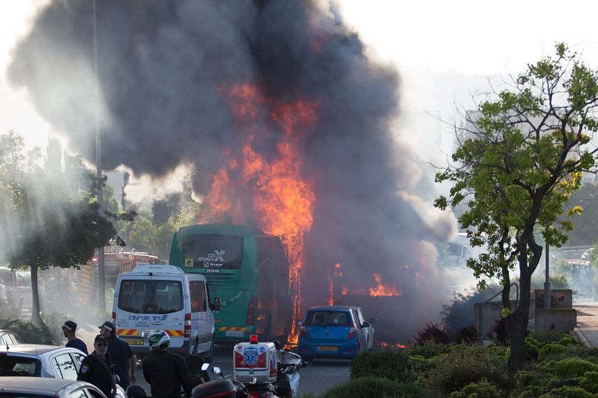 """The bomb sparked a fire which spread to another bus and a car, wounding at least 21 people. Israeli domestic security agency Shin Bet called the explosion a """"terror attack"""", but no group has claimed responsibility for it."""